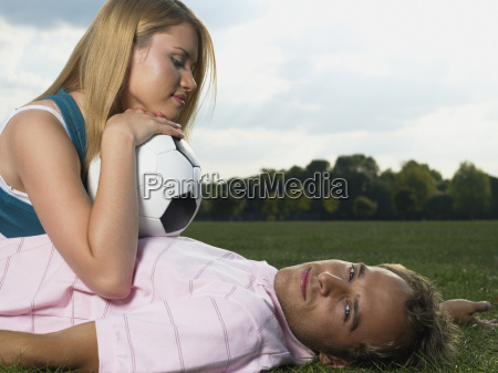 young couple lying in a park
