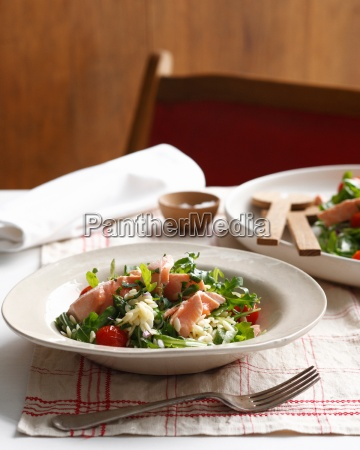 bowl of poached salmon orzo with