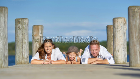 happy young family at the jetty