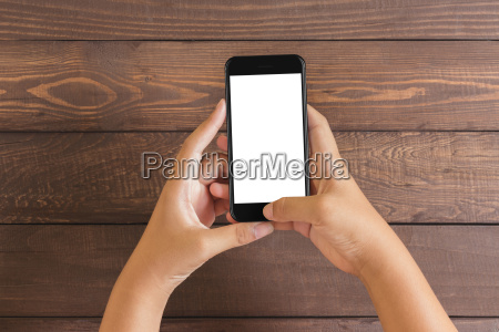 phone in woman hand showing white