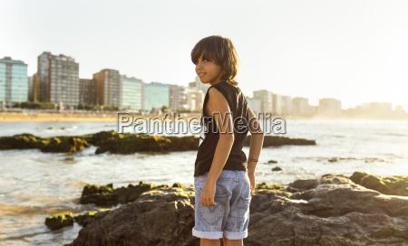 boy on the beach at sunset