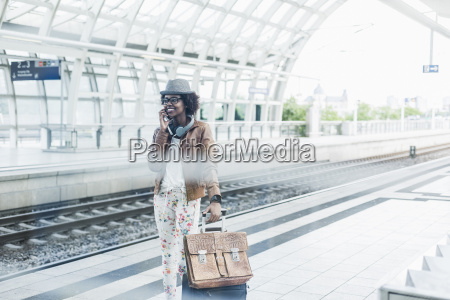 young woman telephoning with smartphone while