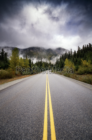 canada highway road and dark clouds