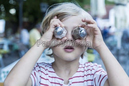 little boy covering his eyes with