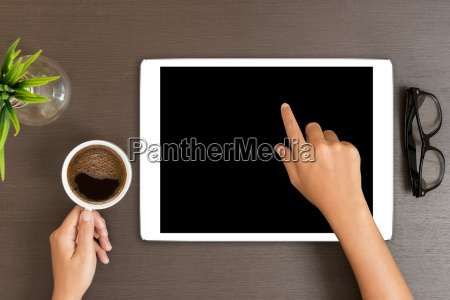 hand use white tablet on desk