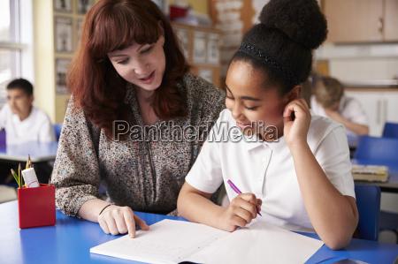primary school teacher with a schoolgirl