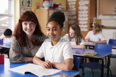 primary school teacher and girl in