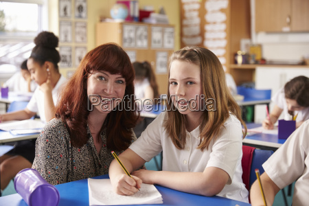 primary school teacher with girl at