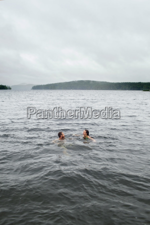couple treading water and talking in