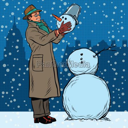 retro uomo e pupazzo di neve