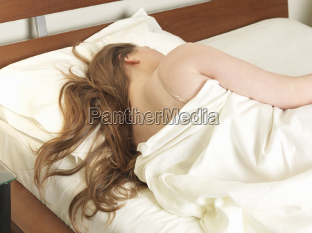 rear view of young woman sleeping