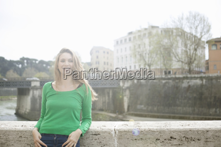 young woman leaning against wall isola