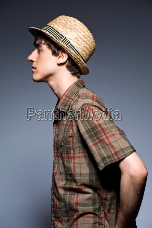 young man wearing hat and short