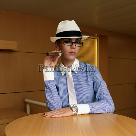 businesswoman holding a cigar