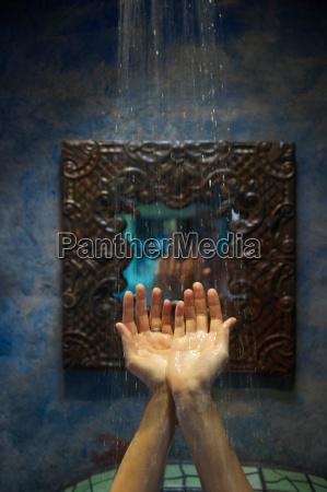 hands under shower water