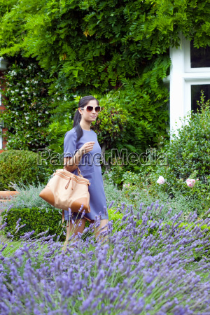 woman walking in garden