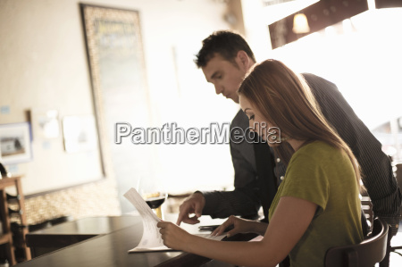 business partners looking at paperwork in