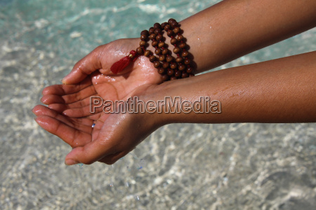 close up of hands holding water