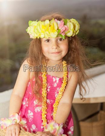 girl wearing flower garland in hair