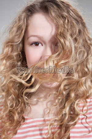 teenage girl with hair covering face