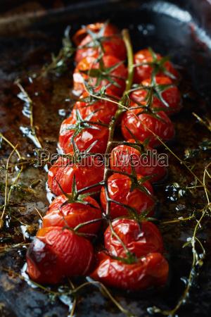 roasted cherry tomatoes on vine