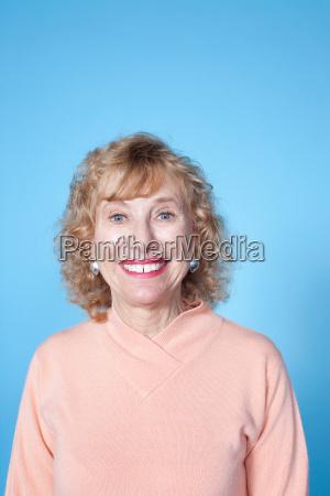senior woman looking at camera studio