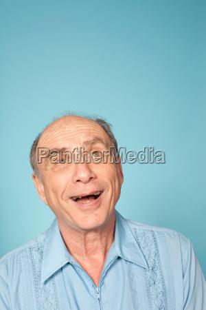 senior man looking up studio shot