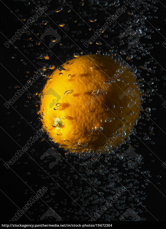 orange, in, bubbles, , black, background - 19472304