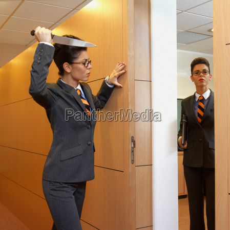businesswoman holding a knife