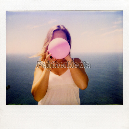 instant, film, photograph, of, woman, blowing - 19474284