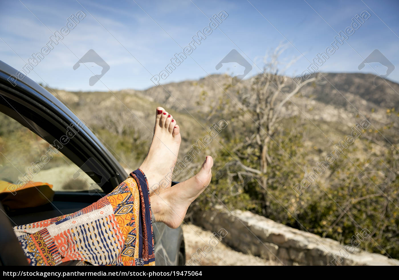 young, womans, feet, sticking, out, car - 19475064