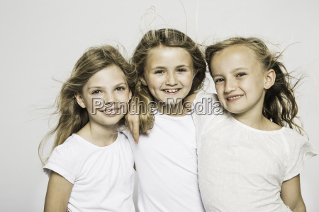 studio portrait of three girls with