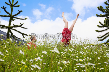 woman doing handstand in garden