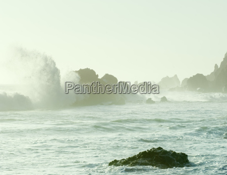 view of ocean waves and rock