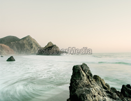 view of ocean tide and rock