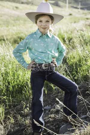 girl wearing cowboy hat with hands