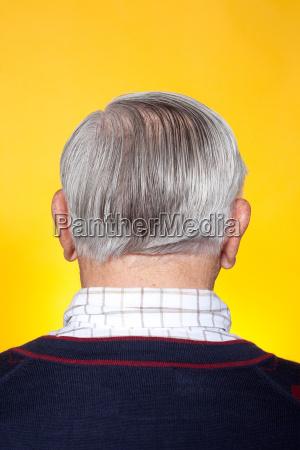 senior man rear view studio shot
