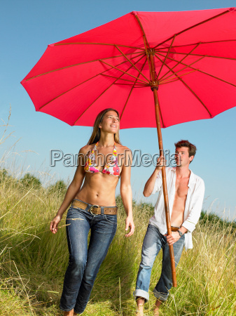 couple with a beach umbrella in