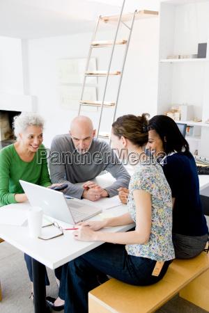 4 business people talking