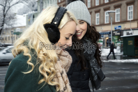 two mid adult women laughing one
