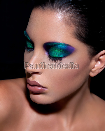 young woman with dramatic eye makeup