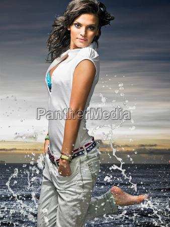 woman kicking up water