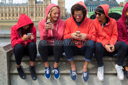 group of young people looking at