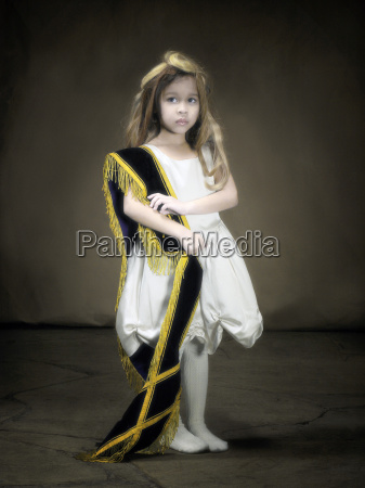 young girl looking sad wearing dress