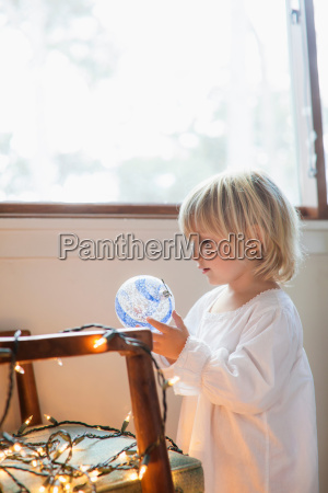 girl looking at blue and white