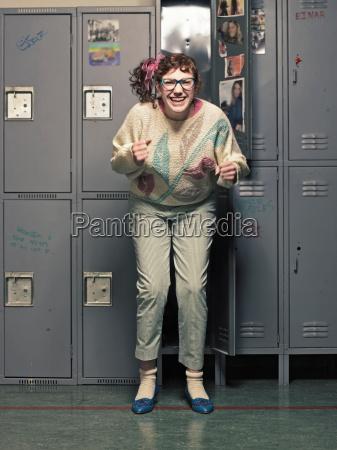 woman in glasses dancing at her