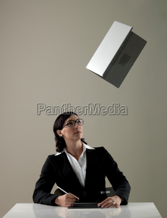 business woman watching laptop