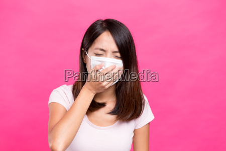 asian woman wearing face mask and