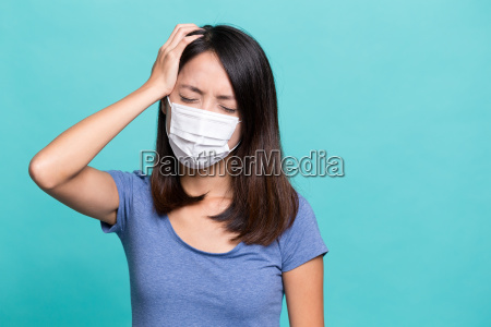 young woman feeling sick and wearing