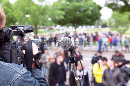 microphone in focus cameraman filming blurred